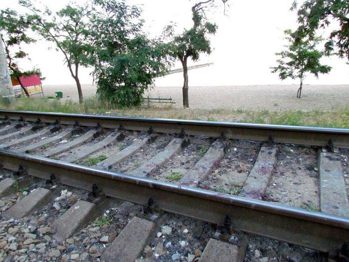 В курортной зоне Мариуполя поезд отрезал парню обе ноги (ФОТО), фото-5
