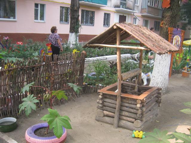 В Мариуполе жители за 2 года превратили заброшенный пустырь в лучший двор (ФОТО), фото-2