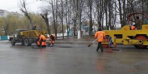 Дощ іде – а у Вінниці дороги асфальтують (ФОТО), фото-5