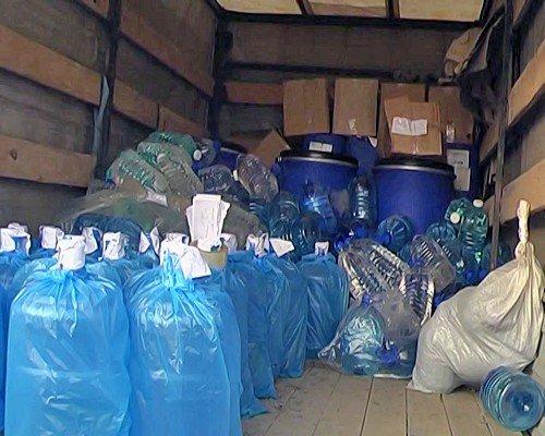 Луганчанин в гараже разливал «чудо-водку» (фото), фото-1