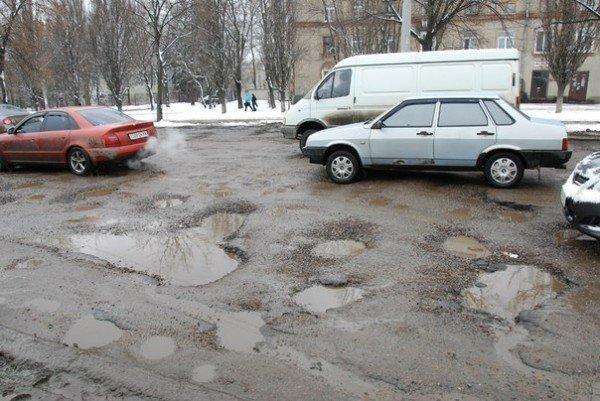 В Харьков пришла весна и вернулись разбитые дороги (фоторепортаж), фото-5