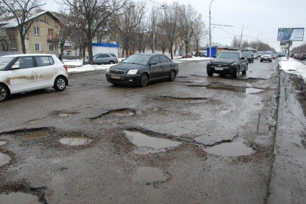 В Харьков пришла весна и вернулись разбитые дороги (фоторепортаж), фото-7