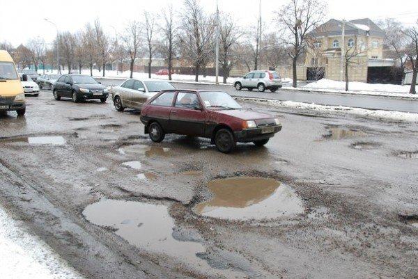 В Харьков пришла весна и вернулись разбитые дороги (фоторепортаж), фото-2