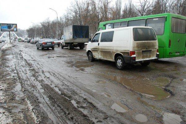 В Харьков пришла весна и вернулись разбитые дороги (фоторепортаж), фото-8