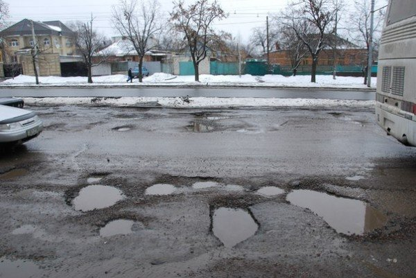 В Харьков пришла весна и вернулись разбитые дороги (фоторепортаж), фото-9