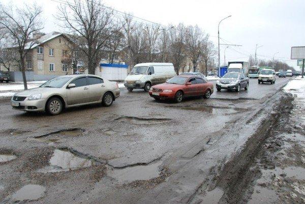 В Харьков пришла весна и вернулись разбитые дороги (фоторепортаж), фото-10
