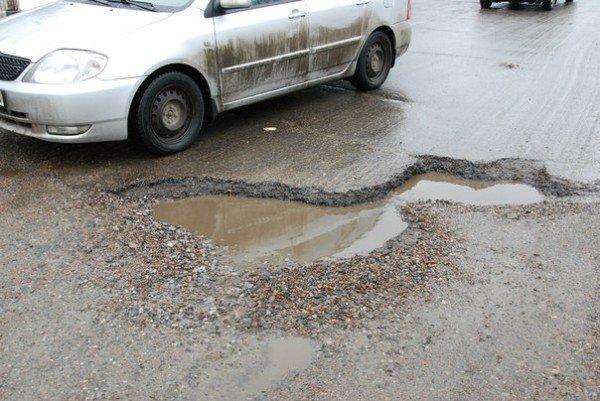 В Харьков пришла весна и вернулись разбитые дороги (фоторепортаж), фото-12