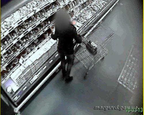 В Мариуполе дама на внедорожнике воровала в супермаркете красную икру (ФОТО), фото-1