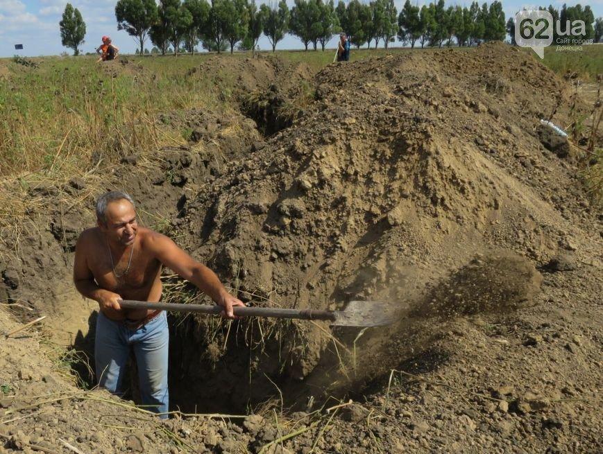 Жители Мариуполя активно готовят город к отражению штурма российской армии (ФОТО+ВИДЕО), фото-3
