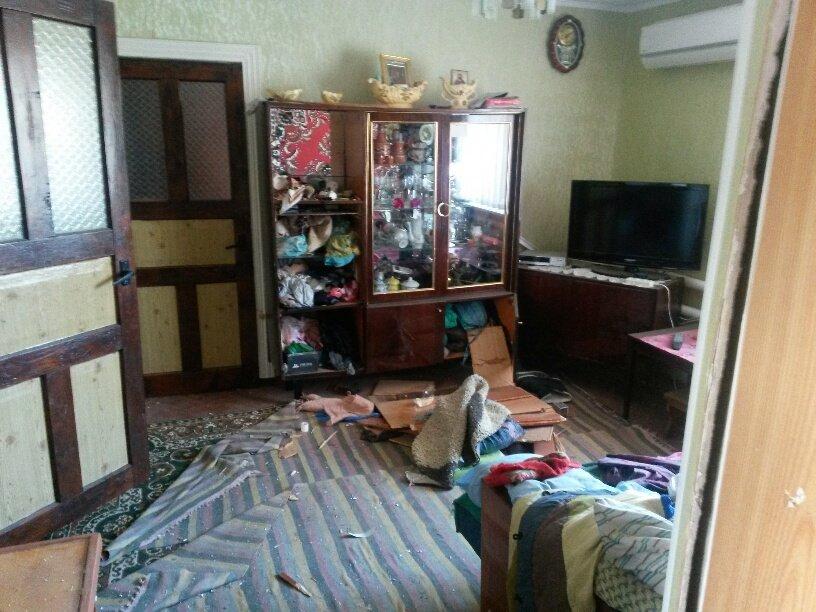 В результате обстрела жительница Талаковки попала в больницу (ФОТОРЕПОРТАЖ), фото-2