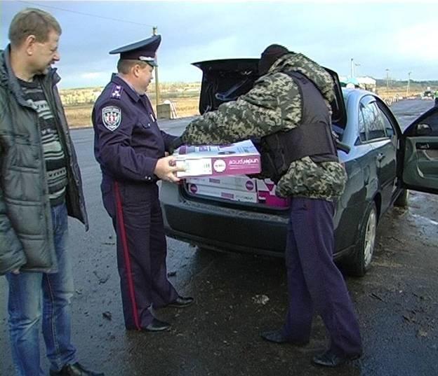 Запорожская милиция развезла на отдаленные блокпосты медикаменты и обогреватели (ФОТО) (фото) - фото 1