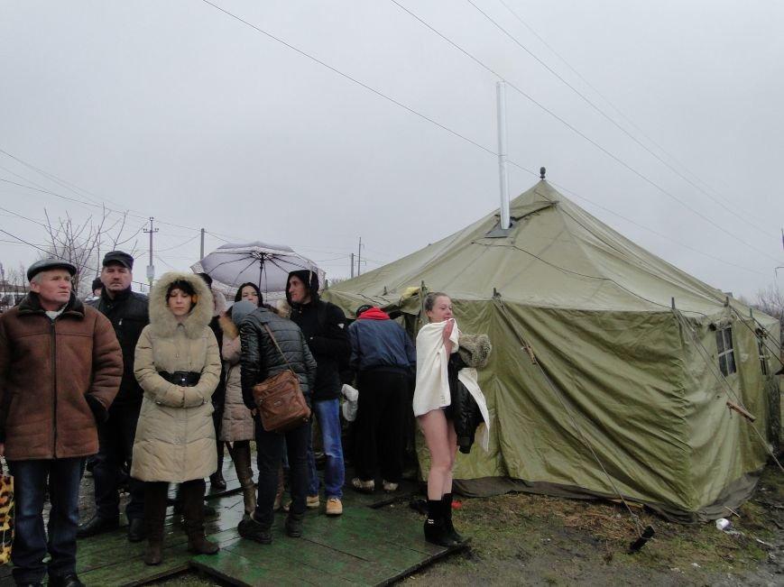 Хмельницький зустрів Водохреща дощем та козацьким кулішем (фото) - фото 2