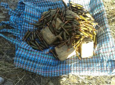 Правоохранители Сумщины в зоне АТО обнаружили тайник с оружием и боеприпасами (ФОТО) (фото) - фото 1