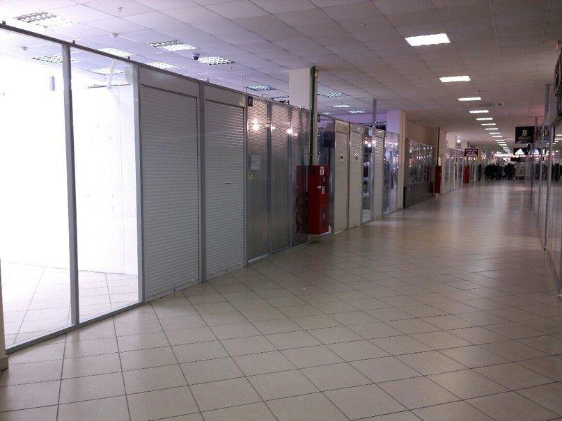 Фотофакт:торговый армагеддец. В торговом центре «Секрет» опустели роллеты (фото) - фото 6