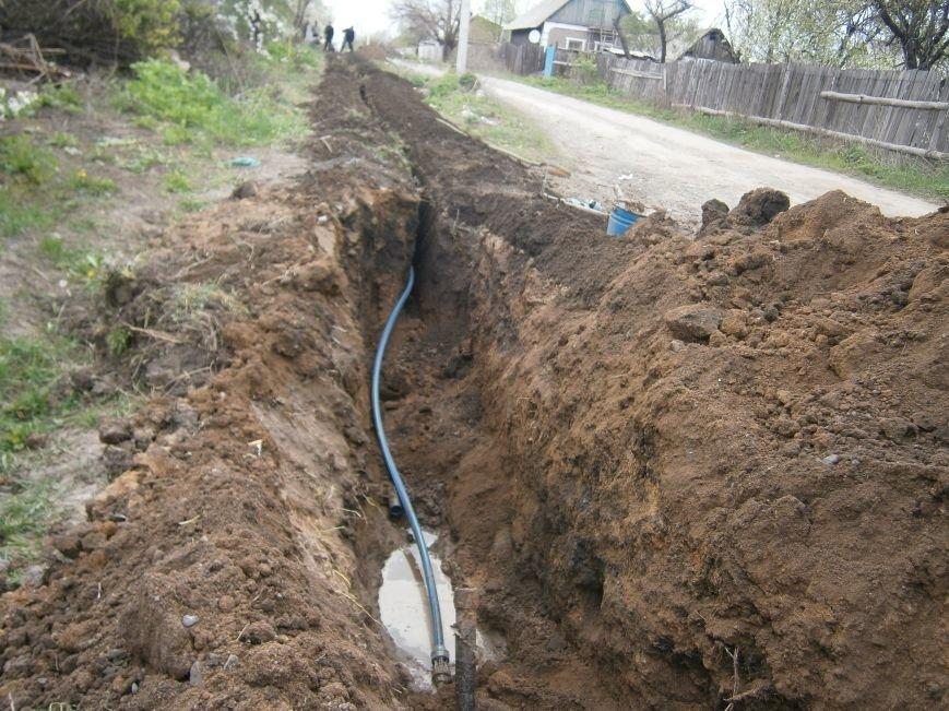 Димитровский водоканал совместно с жителями меняет водопроводные сети (Фоторепортаж) (фото) - фото 9