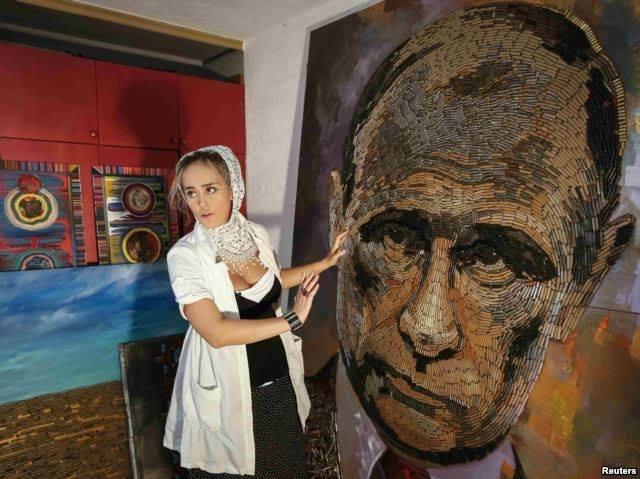 Художница Дарья Марченко сложила портрет Путина из 5000 донбасских гильз, фото-1