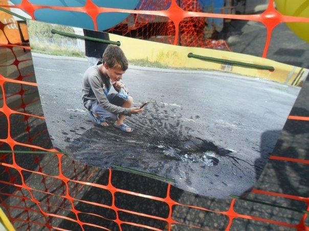 «Я не хочу війни»: У Львові показали зворушливі фотографій дітей переселенців (ФОТО) (фото) - фото 1