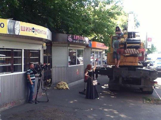 В Киеве владелица МАФа грозится вскрыть себе вены (фото) - фото 1