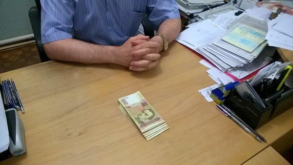 В Харькове чиновник миграционной службы брал взятки с переселенцев (ФОТО), фото-2