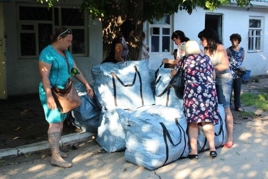 Предпринимателям начали выдавать вывезенное с рынка по ул. Козлова имущество (ФОТО) (фото) - фото 7