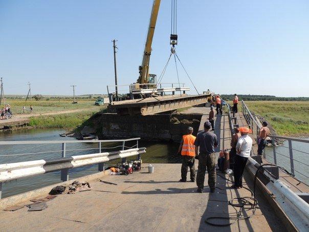На Николаевщине восстановили разрушенный зерновозами мост (ФОТОТАКТ) (фото) - фото 5