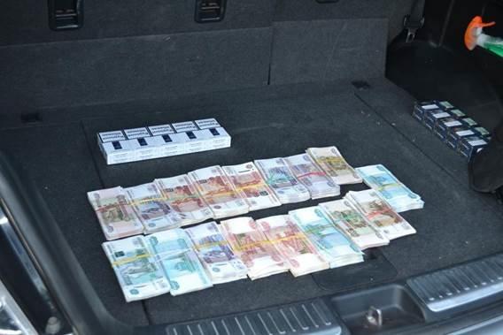 В Запорожской области СБУ заблокировала схему незаконного обмена денег, украденных в Луганске (фото) - фото 1