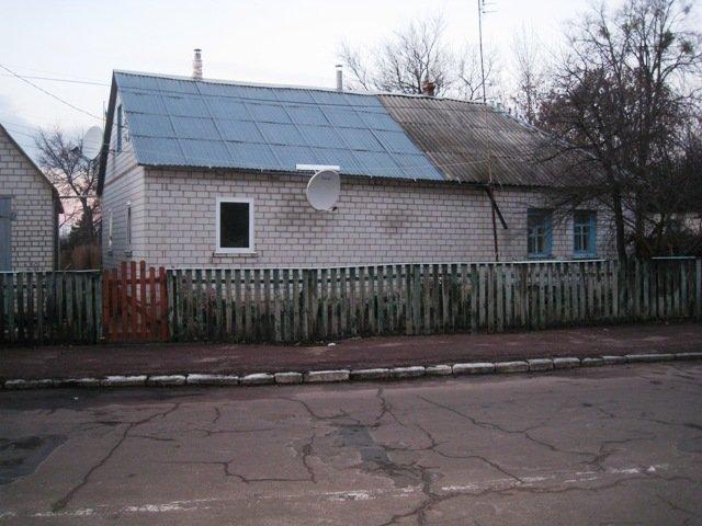 На Житомирщине соседи вынесли с горящего дома спящую хозяйку (фото) - фото 1