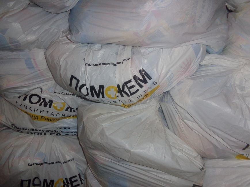 Переселенцам на заметку: в Красноармейске продолжается выдача гуманитарной помощи (фото) - фото 1