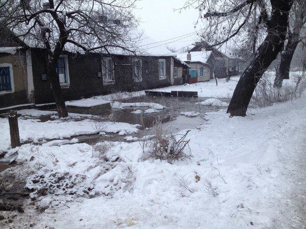 Рождественское чудо: на главной улице Доброполья появился неведомый пруд (ФОТО) (фото) - фото 1