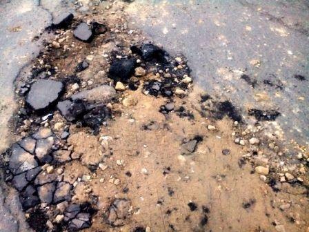 Ремонт дорог по-херсонски (фото) (фото) - фото 2