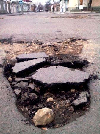 Ремонт дорог по-херсонски (фото) (фото) - фото 4