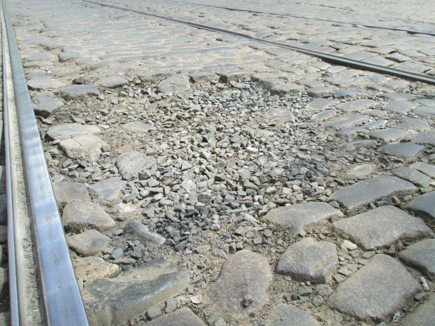ddf8c4e3339668fb6bbedc7b2fbacd53 В лужу или яму? Одесские дороги предоставляют богатый выбор