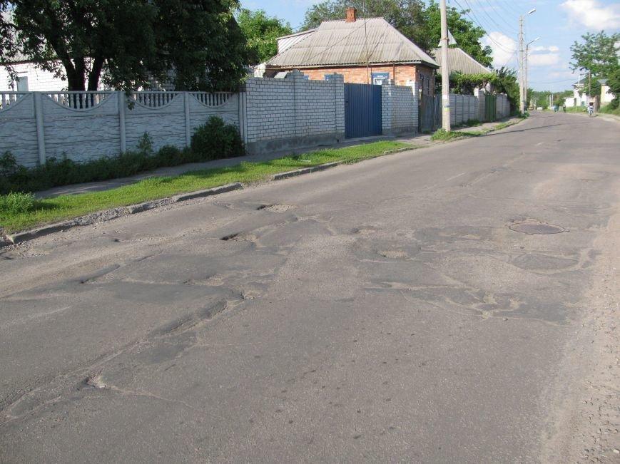Окраины Кременчуга: чтобы проехать по Крюкову, водители вынуждены разбивать бордюры и нарушать ПДД (ФОТО), фото-7