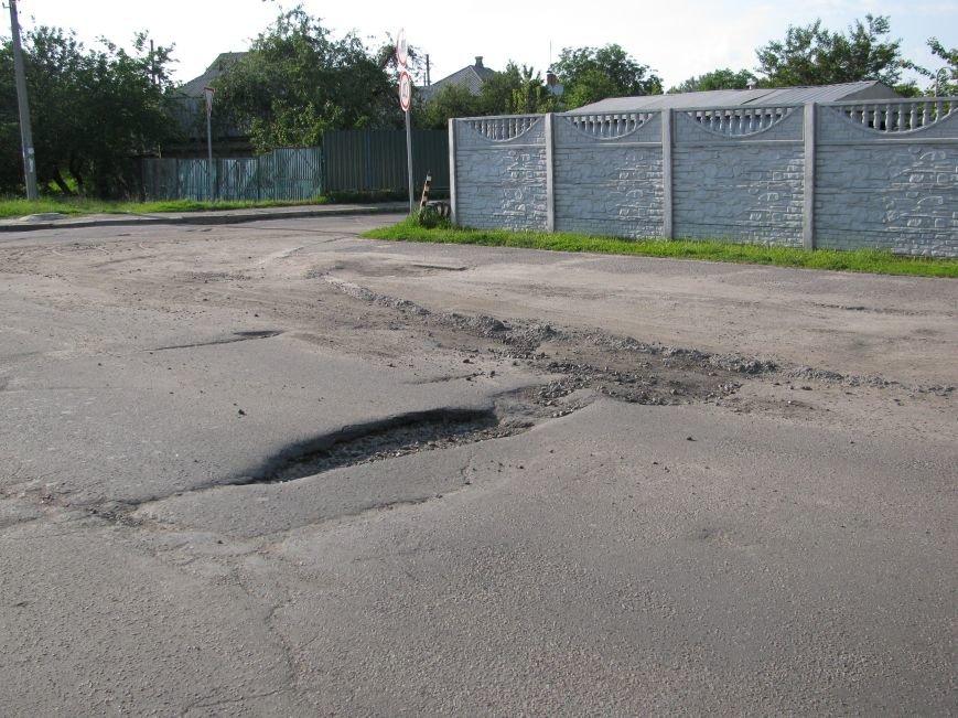 Окраины Кременчуга: чтобы проехать по Крюкову, водители вынуждены разбивать бордюры и нарушать ПДД (ФОТО), фото-6