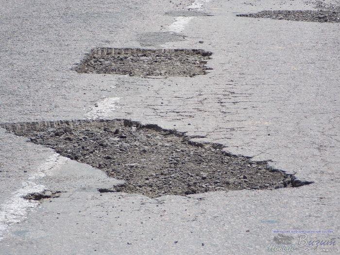 За 10 дней дорожники отремонтировали 2 км дороги, которая соединяет Геническ и трассу Харьков-Симферополь (фото), фото-1