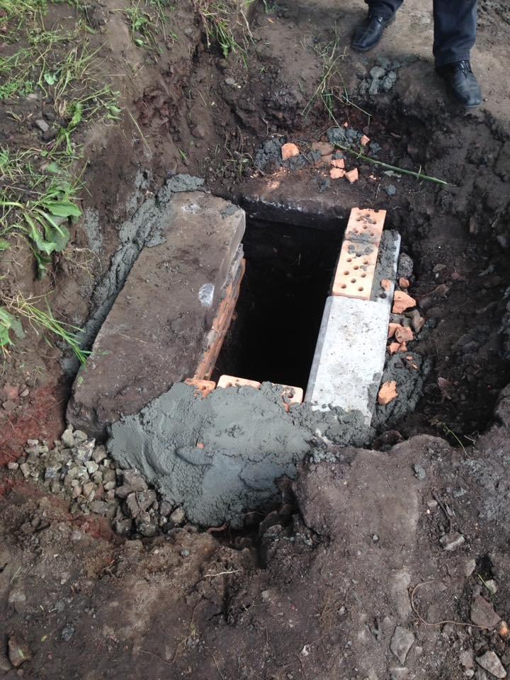 В Кривом Роге под полутораметровым слоем земли нашлись ливневки (ФОТО), фото-4