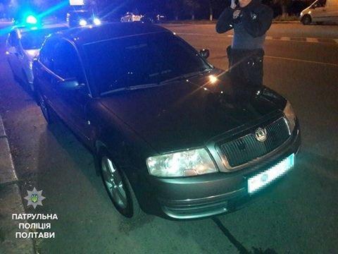 Полтавские копы задержали вооруженного кременчужанина на авто с поддельными госномерами, фото-3