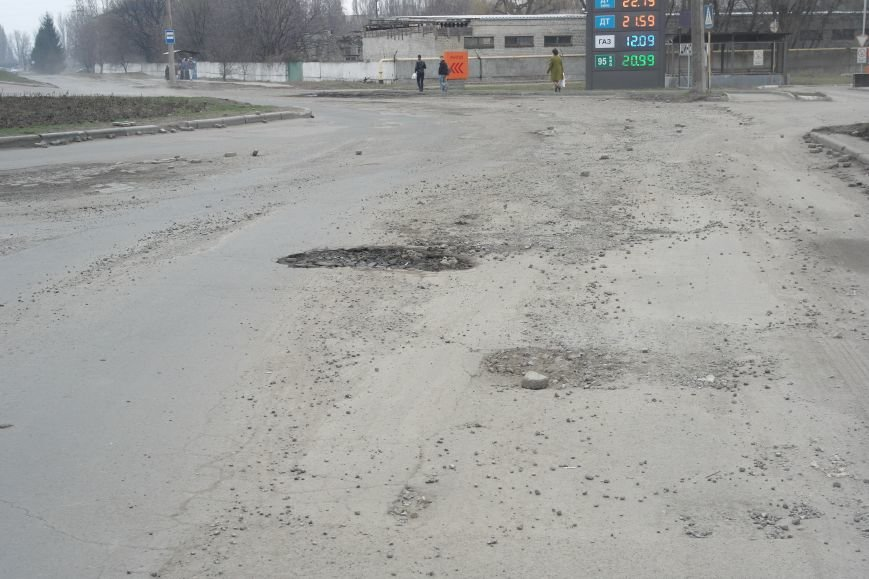 Берегите авто: водители шокированы «убитыми» дорогами под «Димитровским» мостом (ФОТО, ВИДЕО), фото-1