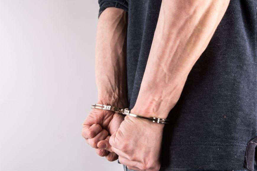 hands-in-handcuffs-1462608294Qt0